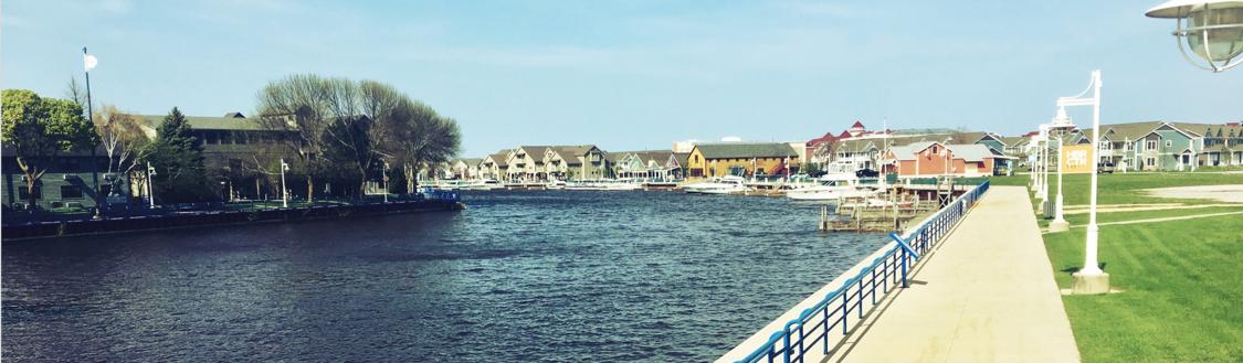 Sheboygan River with restaurants, shops, condos, and boat slips