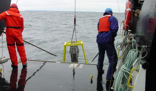Researchers bring in a machine that collects Lake Michigan data