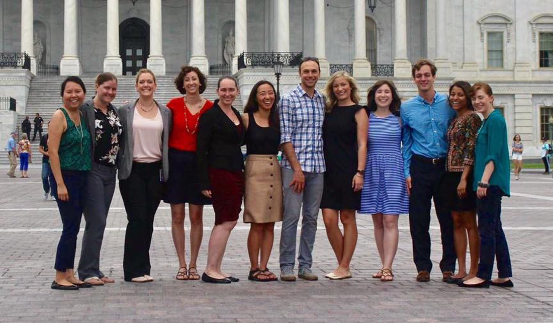 Group of Knauss Fellow graduate students standing in front of the Capitol Building in Washington, D.C.