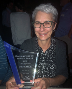 Irene Miles holds the Communications Service Award